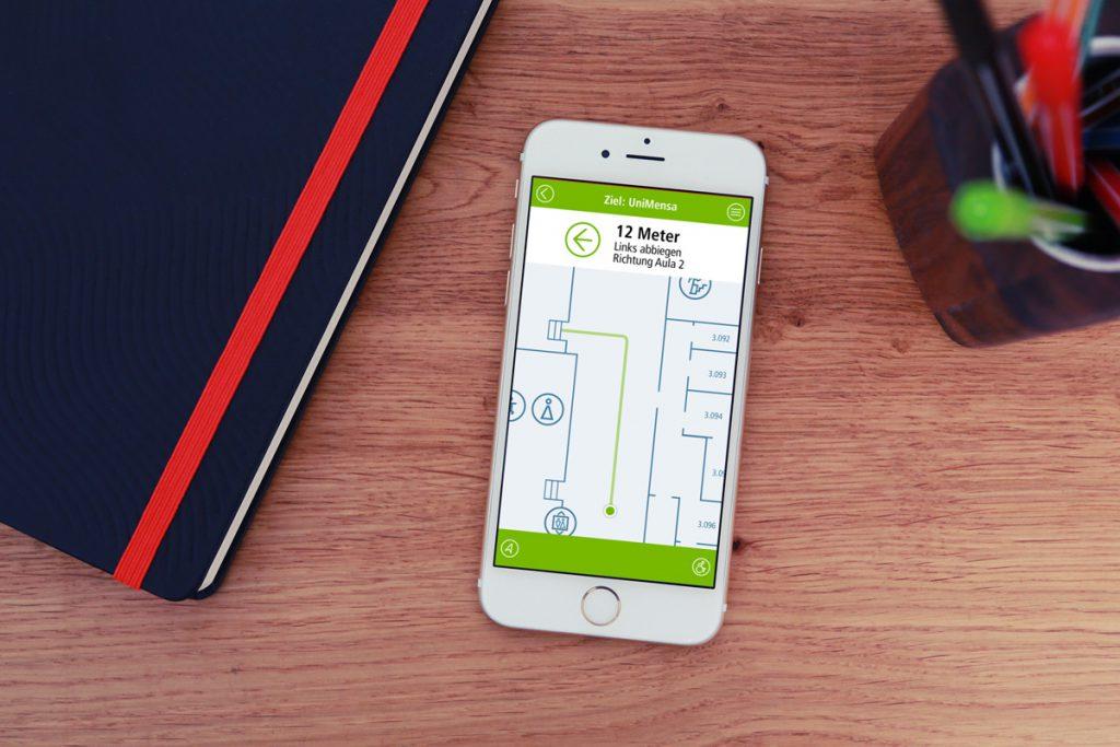 Smartphone mit Entwurf für ein Navigationssystem für die Uni Köln