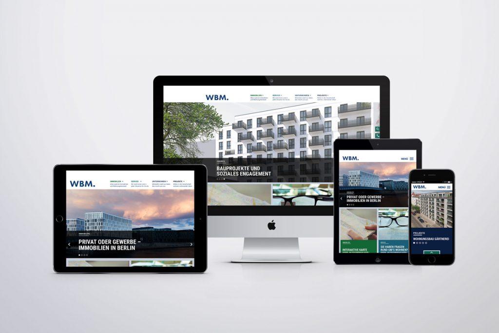 Smartphone, Tablet und Computer mit Entwurf einer Webseite für WBM Immobilien