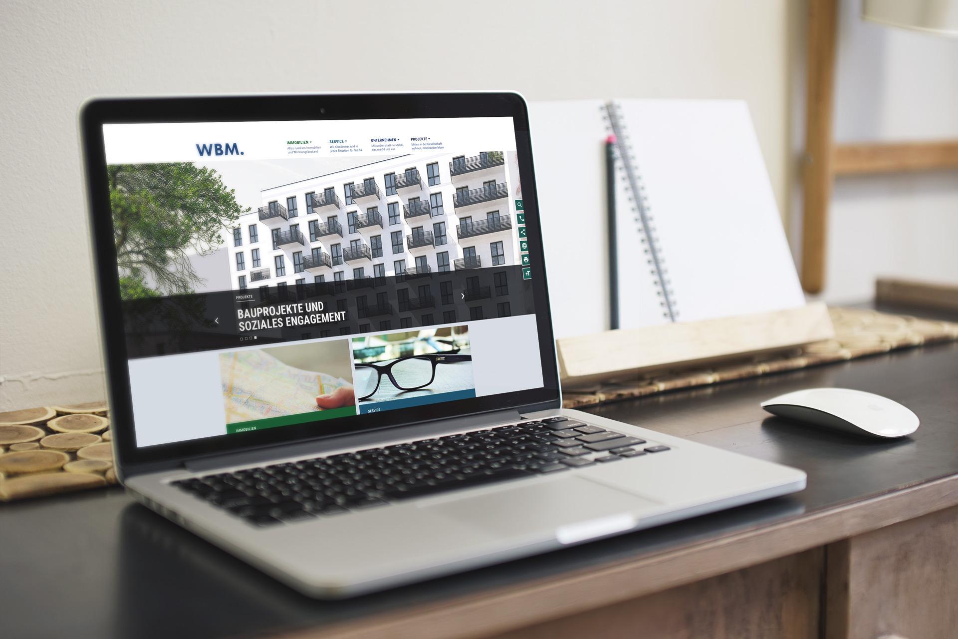 WBM Immobilien Unternehmensseite auf einem Laptop